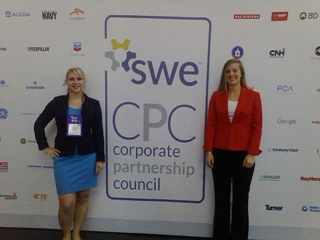 Photo of SWE members posing in front of the SWE Corporate Partnership Council sign at the national SWE conference